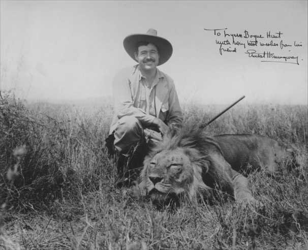 Ernest Hemingway and hunted lion